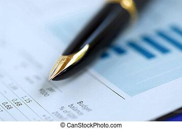 Pen finance graph - Golden fountain pen on financial papers