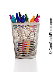 a background of desk top pen holder full of brightly colored pens on a white background