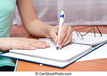 pen in left hand writing