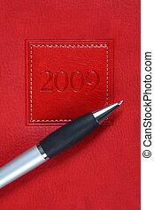 pen on a 2009 year planner / organizer