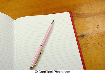 pen on a notebook