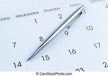 Pen on calendar page closeup
