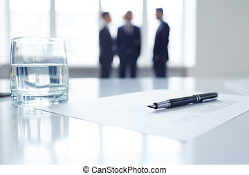 Pen on document and glass of water - Image of business ...