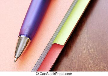 Pen on Files - Macro of blue pen on multicolored files