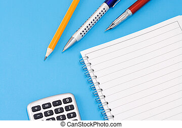 pen, pencil and calculator with pad