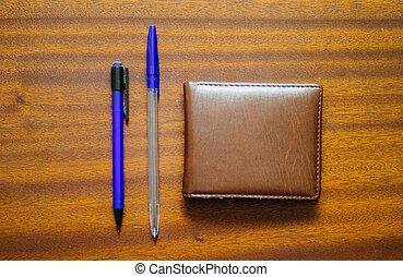Pen, Pencil And Money Wallet