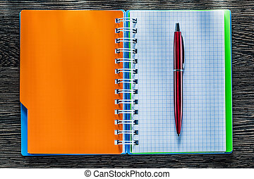 Pen spiral checked notebook on vintage wooden board