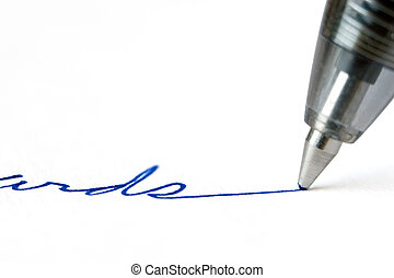 A pen writing on white paper