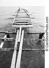 Wooden pier on the sea background
