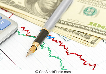Pen,calculator and dollars on chart closeup. Business concept