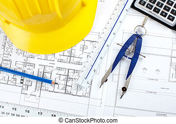 construction drawing - pencil and calculator over a ...