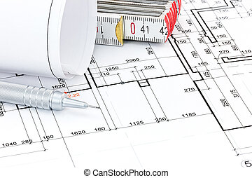 pencil and folding ruler on architectural blueprint floor plan