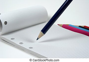 Pencil and Pad - Photo of a Pad and Colored Pencils.