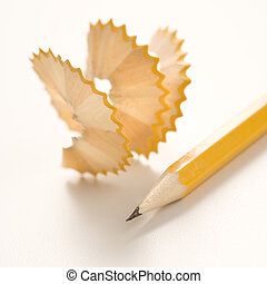 Pencil and shavings. - Sharp pencil next to spiral pencil...