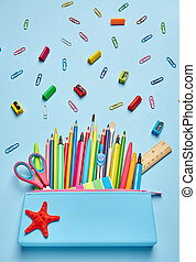 Pencil case with bright office supplies. Colorful Back to School background