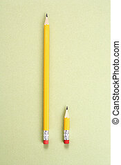 Pencil comparison. - One long pencil and one short pencil...