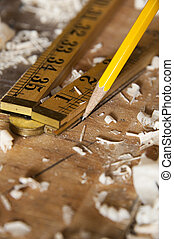 Pencil drawing line with folding ruler on wood