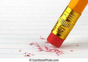 Pencil Eraser - Close up of pencil eraser on lined paper