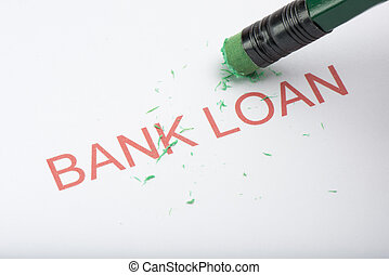 Pencil Erasing the Word 'Bank Loan' on Paper