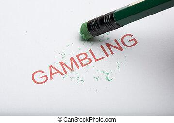 Pencil Erasing the Word 'Gambling' on Paper