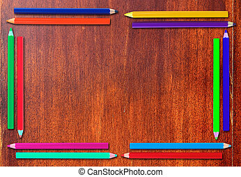Pencil Frame  on old wooden background