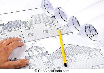 pencil, hand, blueprints on desktop