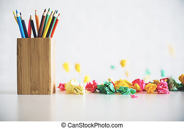 Pencil holder on messy table
