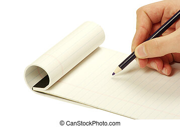 Pencil in hand writing on the notebook