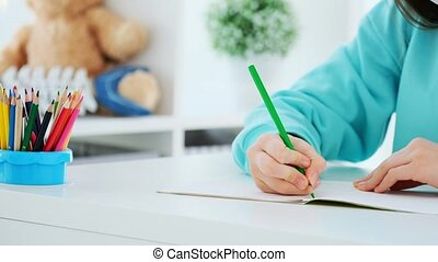 Pencil in hands of girl - Close up view of green pencil in ...