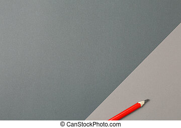 pencil on a two-tone gray background top view.