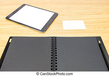 pencil on blank black book with table and business card on wooden table, Mock up for adding your content