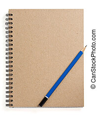 pencil on checked notebook at white