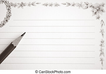 Pencil on notebook with space for text