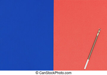 Pencil on red blue paper background