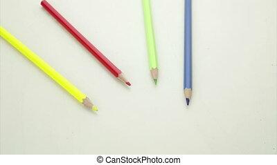 Pencil shavings falling on pencils