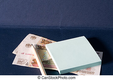 Pencil, two banknotes of one hundred rubles, stickers on a blue background