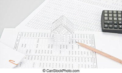 Pencil with pile of paperwork like - Pencil on finance...