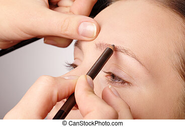 Penciling eyebrow for young girl - Stylist is penciling...