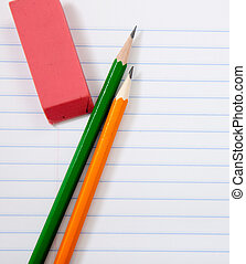 Pencils and an eraser on notebook paper - colorful pencils...