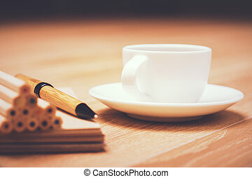 Pencils and coffee cup