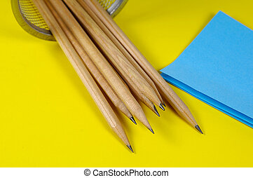 Pencils and Postits - Pencils and Blue Postit Notes on a...