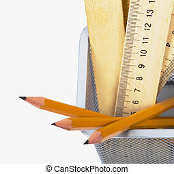 Pencils and rulers - Simple pencils , wooden rulers in a...