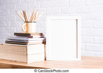 Pencils and white frame - Desk with blank white picture ...