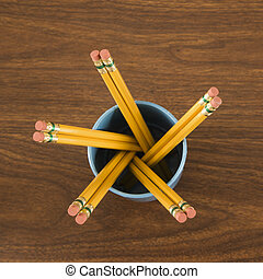 Pencils in cup.