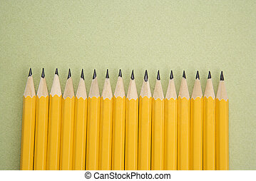 Pencils in even row. - Sharp pencils arranged in an even...