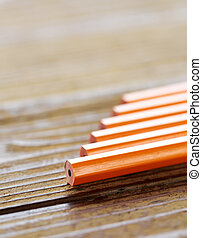 pencils lying on wood table