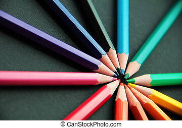 Pencils of different colors close up isolated on black