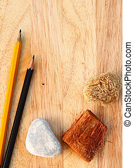 Pencils on decorated wood background with copy space