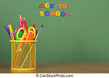 Pencils, scissors in a support - Back to school. Pencils,...