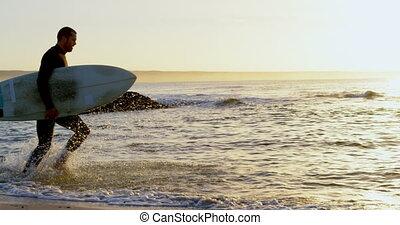 pendant, côté, vue mer, mâle, surfeur, coucher soleil, caucasien, 4k, courant, planche surf, mi-adulte